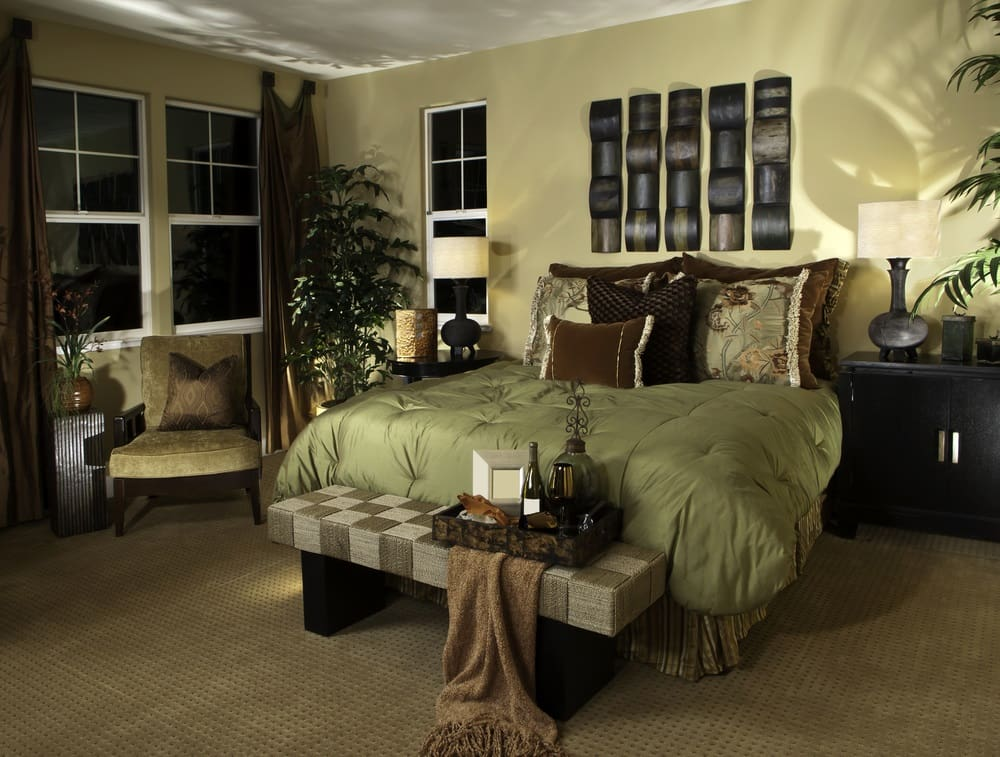 Bedroom with light green theme and plants