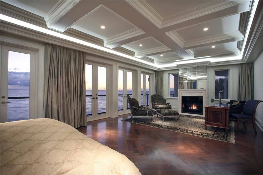 Bedroom with multiple glass doors waterfront