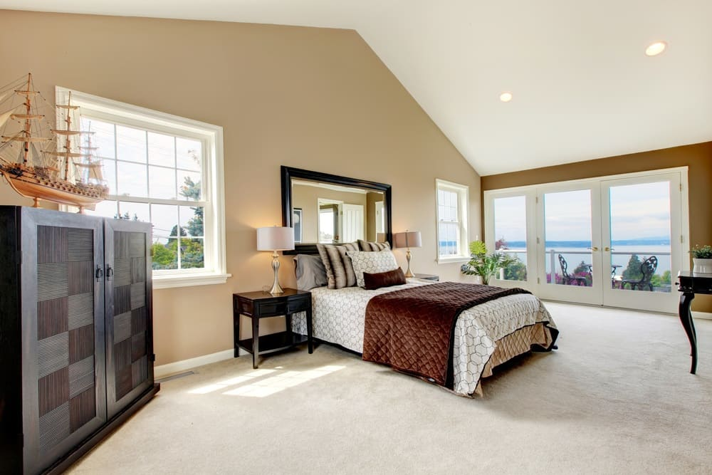 Bedroom with odd sloped ceiling private balcony ocean