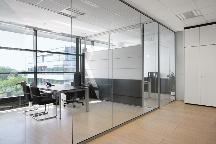Adding blinds can add a layer of privacy and reduce distractions in glass-walled offices.