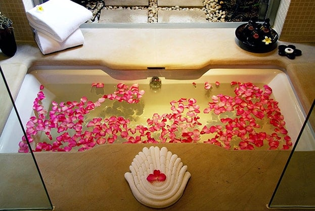 Adding some flowers can always create a more sensual energy in your bathroom.
