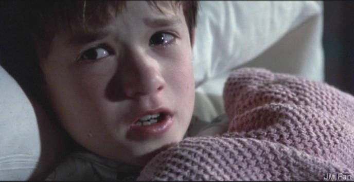 """A scene from the movie """"The Sixth Sense."""" Many movies depict children engaging some other-worldly beings. It is said that they are more approachable because they have yet to grow to their full strength."""