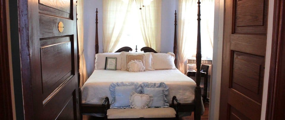 """Not only does the bed above faces the door in a """"coffin position"""", the head of bed is also under a window. Both of which should be avoided."""