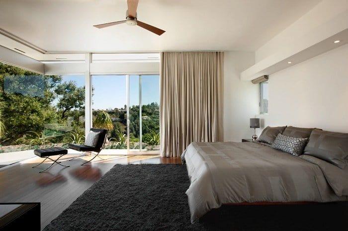 headboards-Bedroom-Modern-with-ceiling-fan-corner-window-curtains-glass-walls-gray-bedspread-feng-shui-light-corner-min (Demo)