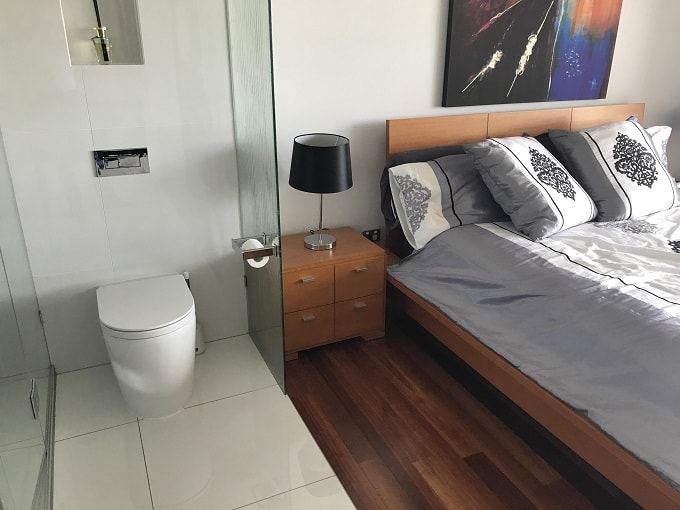 toilet sharing wall with bed feng shui-min (Demo)