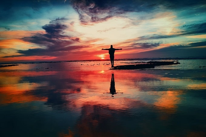 embracing sun in ocean-min